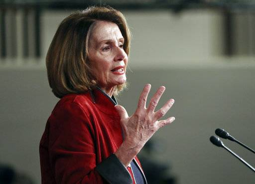FILE - In this Jan. 11, 2018, file photo, House Minority Leader Nancy Pelosi of Calif., gestures as she speaks during a news conference on Capitol Hill in Washington. On the heels of President Donald Trump's State of the Union address, Pelosi is expected to target the recently approved federal tax overhaul during a town hall-style meeting in Massachusetts. Her appearance at the event in Cambridge on Thursday, Feb. 1, is part of what organizers say is a nationwide tour featuring members of Congress and others to call attention to the Republican tax plan.