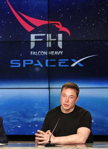 Elon Musk, founder, CEO, and lead designer of SpaceX, speaks at a news conference after the Falcon 9 SpaceX heavy rocket launched successfully from the Kennedy Space Center in Cape Canaveral, Fla., Tuesday, Feb. 6, 2018.