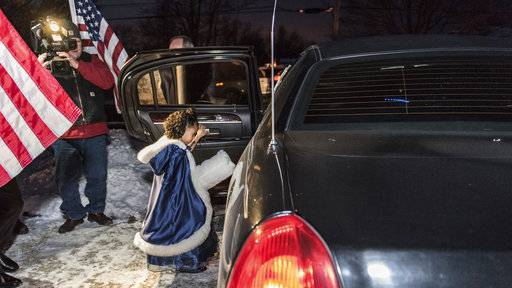 In this photo provided by the Illinois National Guard/U.S. Army, Cayleigh Hinton, daughter of Army Sgt. Terrence Hinton, gets into a limo that will take her to a father-daughter dance at the Our Lady of Humanity School in Beach Park, Wednesday, Feb. 7, 2018, in Winthrop Harbor, Ill. Cayleigh was escorted to the dance by 1st Sgt. Joseph Bierbrodt of Sheridan, Ill., with the 933rd Military Police Company. Cayleigh's father, Army Sgt. Terrence Hinton, died in a training accident May 14, 2017 in Hawaii. (Staff Sgt. Robert R. Adams/Illinois National Guard/U.S. Army via AP)