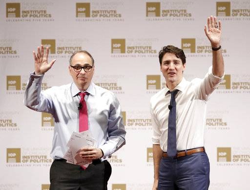Founder and director, David Axelrod, left, and Canadian Prime Minister Justin Trudeau, acknowledges the audience's applause after Trudeau's appearance at the University of Chicago Institute of Politics, Wednesday, Feb. 7, 2018, in Chicago.