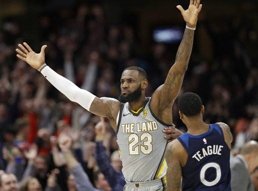 Cleveland Cavaliers' LeBron James, left, celebrates after making the game-winning basket in overtime in an NBA basketball game against the Minnesota Timberwolves, Wednesday, Feb. 7, 2018, in Cleveland. The Cavaliers won 140-138 in overtime.