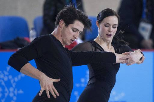 Canadian ice dancers Tessa Virtue and Scott Moir go through their routine during a practice session ahead of the 2018 Winter Olympics in Gangneung, South Korea, Wednesday, Feb. 7, 2018. (Paul Chiasson/The Canadian Press via AP)