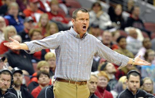 Louisville coach Jeff Walz argues a call during the first half of the team's NCAA college basketball game against Clemson, Wednesday, Feb. 7, 2018, in Louisville, Ky.