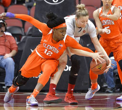 Clemson guard Aliyah Collier (12) and Louisville forward Kylee Shook reach for a loose ball during the first half of an NCAA college basketball game Wednesday, Feb. 7, 2018, in Louisville, Ky.
