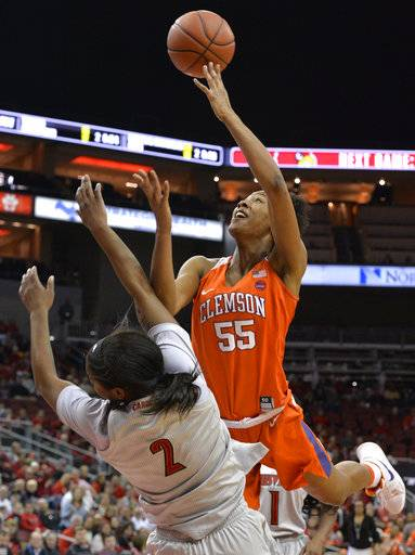 Clemson forward Tylar Bennett (55) knocks down Louisville forward Myisha Hines-Allen (2) as she attempts a layup during the first half of an NCAA college basketball game Wednesday, Feb. 7, 2018, in Louisville, Ky.