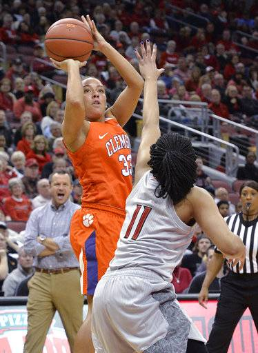 Clemson guard Alexis Carter (33) shoots over Louisville guard Arica Carter (11) during the first half of an NCAA college basketball game Wednesday, Feb. 7, 2018, in Louisville, Ky.