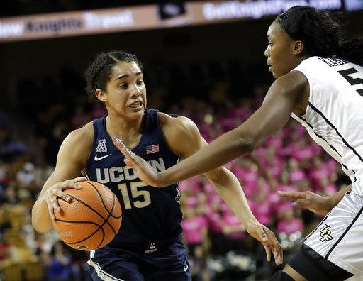 Connecticut forward Gabby Williams (15) looks to move past Central Florida forward Masseny Kaba during the first half of an NCAA college basketball game, Wednesday, Feb. 7, 2018, in Orlando, Fla.