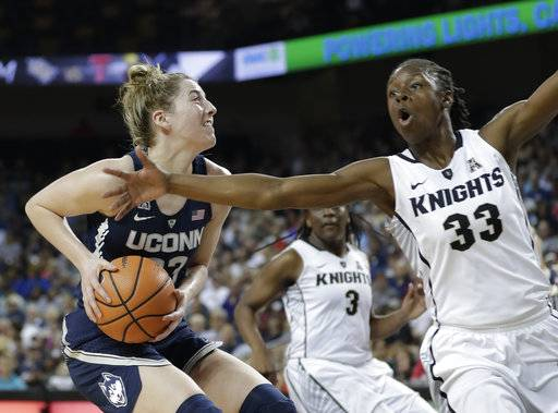 Connecticut forward Katie Lou Samuelson, left, looks for a shot as she is defended by Central Florida's Jamesha Paul (33) during the first half of an NCAA college basketball game, Wednesday, Feb. 7, 2018, in Orlando, Fla.