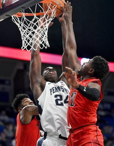 Maryland's Darryl Morsell, right, blocks a shot by Penn State's Mike Watkins during an NCAA college basketball game Wednesday, Feb. 7, 2018, in State College, Pa. (Abby Drey/Centre Daily Times via AP)