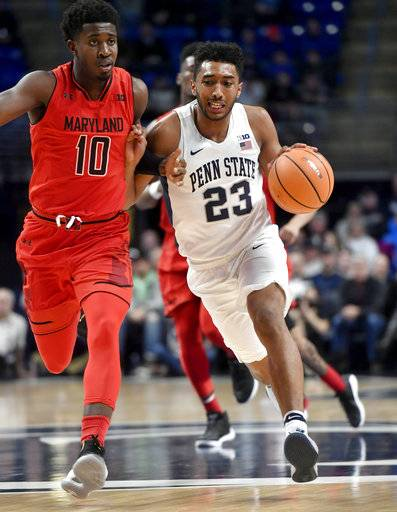 Penn State's Josh Reaves dribbles around Maryland's Darryl Morsell during an NCAA college basketball game Wednesday, Feb. 7, 2018, in State College, Pa. (Abby Drey/Centre Daily Times via AP)