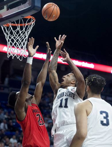 Penn State's Lamar Stevens shoots over Maryland's Bruno Fernando, left, during an NCAA college basketball game Wednesday, Feb. 7, 2018, in State College, Pa. (Abby Drey/Centre Daily Times via AP)