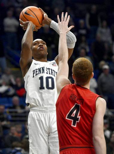 Penn State's Tony Carr shoots over Maryland's Kevin Hurter during an NCAA college basketball game Wednesday, Feb. 7, 2018, in State College, Pa. (Abby Drey/Centre Daily Times via AP)