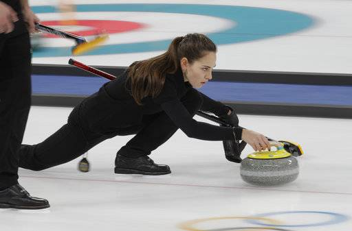 Olympic Athlete from Russia curler Anastasia Bryzgalova prepares to throw her stone during the mixed doubles training session ahead of the 2018 Winter Olympics in Gangneung, South Korea, Wednesday, Feb. 7, 2018.