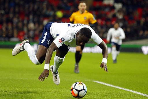 Tottenham's Moussa Sissoko jumps for the ball during the English FA Cup fourth round replay soccer match between Tottenham Hotspur and Newport County at Wembley Stadium in London, Wednesday, Feb. 7, 2018.