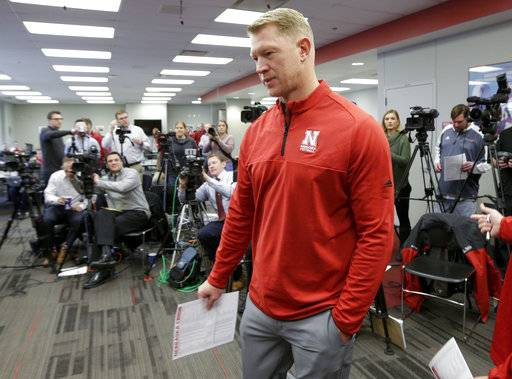 Nebraska coach Scott Frost holds his recruit list as he arrives for an NCAA college football signing day news conference in Lincoln, Neb., Wednesday, Feb. 7, 2018.
