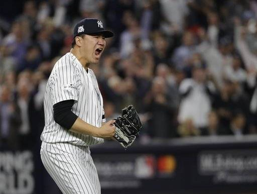 "FILE - In this Oct. 18, 2017, file photo, New York Yankees starting pitcher Masahiro Tanaka reacts after striking out Houston Astros' Josh Reddick in the fifth inning of Game 5 of baseball's American League Championship Series in New York. Tanaka went with his heart when deciding not to opt out of the final three seasons of his $155 million, seven-year contract signed in January 2014 with the New York Yankees. ""My thought was I want to go out and battle with these guys again,"" Tanaka said through a translator, Wednesday, Feb. 7, 2018."