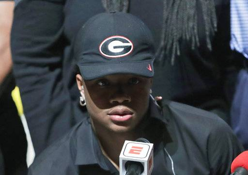 Tyson Campbell, a defensive back from the football team at American Heritage High School, announces he is signing with Georgia on national signing day, Wednesday, Feb. 7, 2018, in Plantation, Fla.