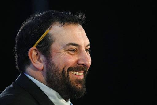 Matt Patricia smile while being introduced as the new head coach of the Detroit Lions during an NFL football news conference at the team's training facility in Allen Park, Mich., Wednesday, Feb. 7, 2018.