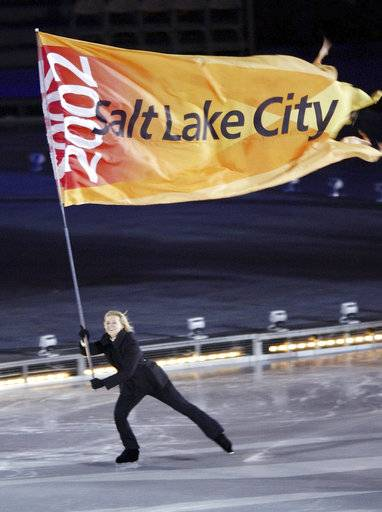 FILE--In this Feb. 8, 2002, file photo, the Salt Lake City Olympic flag is skated into the Rice-Eccles Olympic stadium during the opening ceremonies of the 2002 Winter Olympics in Salt Lake City. Salt Lake City has become the first U.S city to announce it will pursue a bid for the 2030 Winter Olympics following an announcement from an exploratory committee that studied the issue.