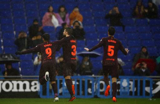 FC Barcelona's Gerard Pique, center, celebrates after scoring during the Spanish La Liga soccer match between Espanyol and FC Barcelona at RCDE stadium in Cornella Llobregat, Spain, Sunday, Feb. 4, 2018.