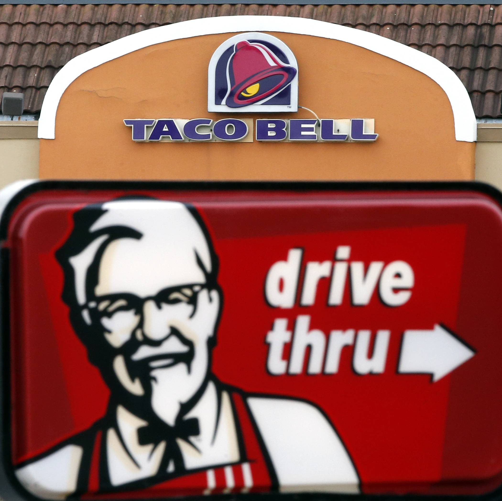 The owner of KFC and Taco Bell is teaming up with Grubhub to expand its delivery business.