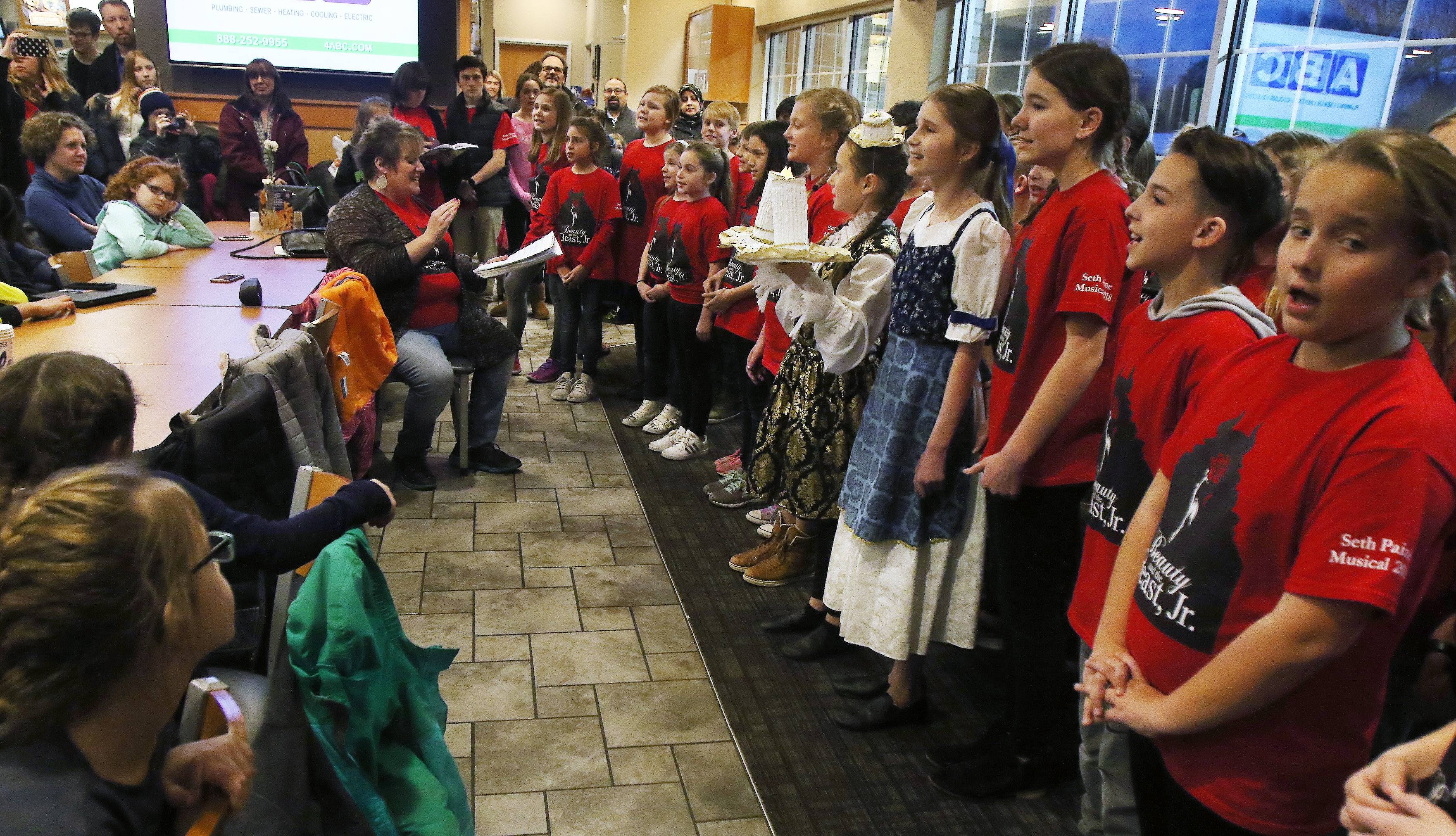 "Students from Seth Paine Elementary School sing ""Be Our Guest"" from ""Disney's Beauty and the Beast Jr."" at Culver's restaurant in Lake Zurich on Thursday."