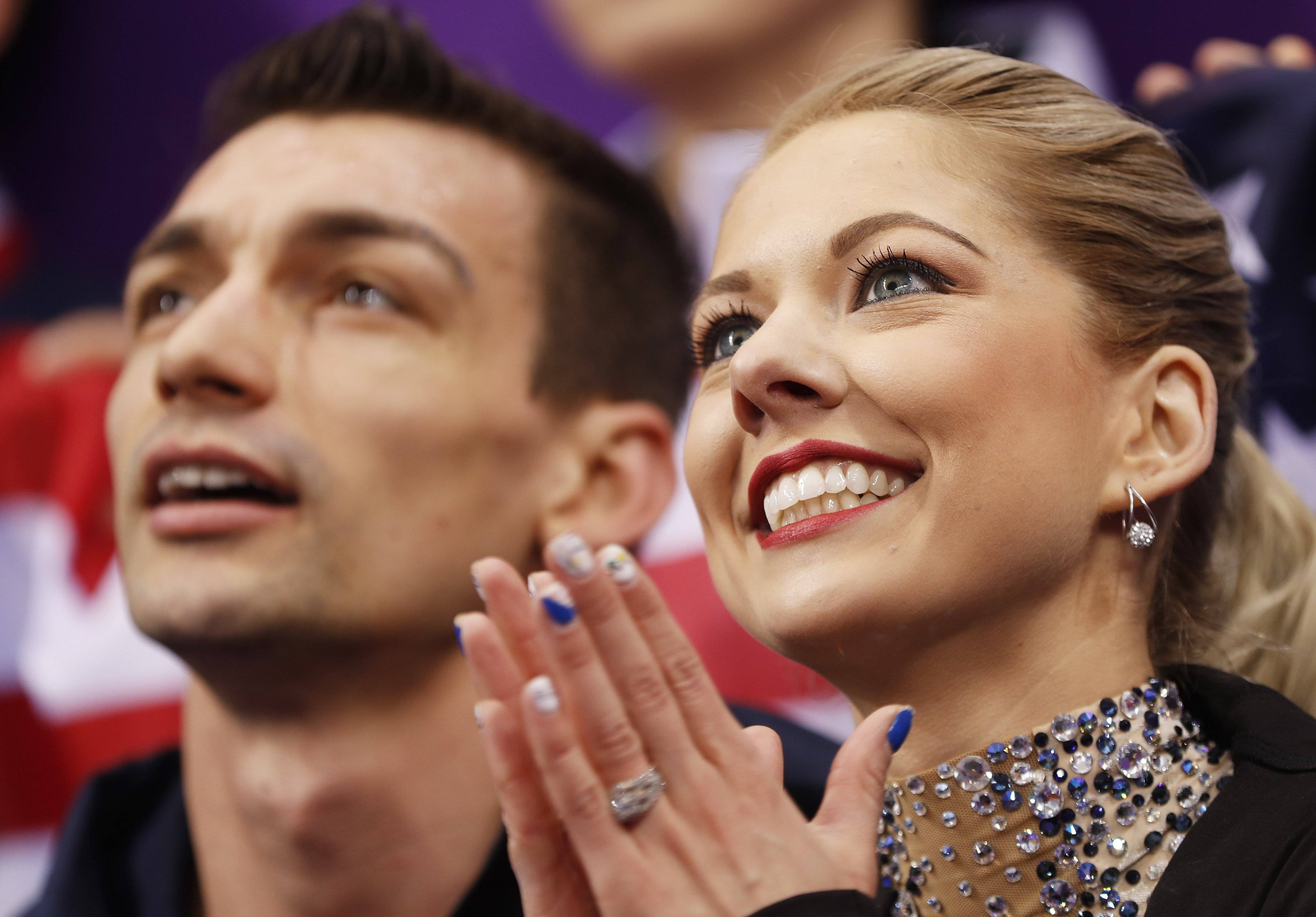 "The pairs team of Addison native Alexa Scimeca Knierim and her partner Chris Knierim are all smiles after a strong performance set to music from ""Moulin Rouge"" helped them lead the U.S team into second place after Day 1 of the figure skating team event at the 2018 Olympics on Friday."