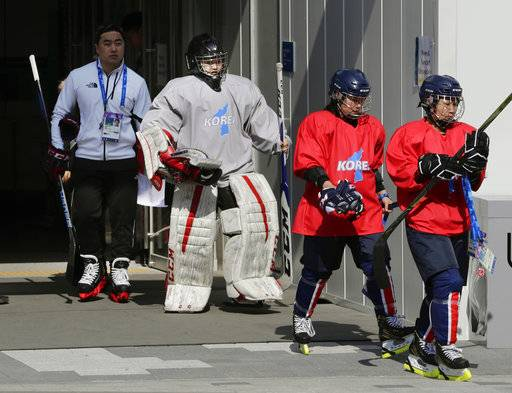 Members of the combined Koreas women's hockey team walk from the Kwandong Hockey Centre to the training center to practice prior to the 2018 Winter Olympics in Gangneung, South Korea, Friday, Feb. 9, 2018.