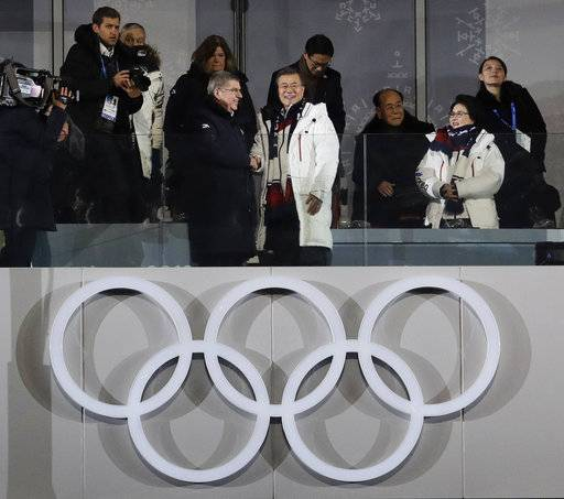 International Olympic Committee President Thomas Bach, left, shakes hands with South Korean President Moon Jae-in as his wife Kim Jung-sook stands second from right near Kim Yo Jong, far right, sister of North Korean leader Kim Jong Un, and Kim Yong Nam, North Korea's nominal head of state, third from right, during the opening ceremony of the 2018 Winter Olympics in Pyeongchang, South Korea, Friday, Feb. 9, 2018.