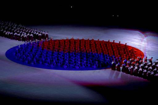 Performers make the Republic of Korea flag during the opening ceremony of the 2018 Winter Olympics in Pyeongchang, South Korea, Friday, Feb. 9, 2018. (Sean Haffey/Pool Photo via AP)
