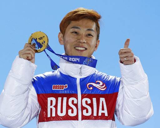 FILE - In this Feb. 15, 2014, file photo, men's 1,000-meter short track speedskating gold medalist Viktor Ahn, of Russia, gestures while holding his medal during the medals ceremony at the Winter Olympics in Sochi, Russia. Sports' highest court rejected appeals by all 45 Russian athletes plus two coaches who were banned from the Pyeongchang Olympics over doping concerns in a decision announced Friday, Feb. 9, 2018, less than nine hours before the opening ceremony. Among those excluded are six-time gold medalist  Ahn, the short track speedskater whose return to his native South Korea for the Olympics had been hotly anticipated by local fans.