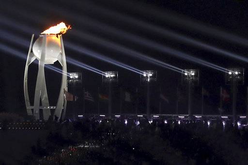 The Olympic flame is lit during the opening ceremony of the 2018 Winter Olympics in Pyeongchang, South Korea, Friday, Feb. 9, 2018. (Sean Haffey/Pool Photo via AP)