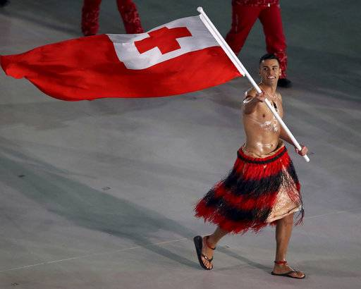 Pita Taufatofua carries the flag of Tonga during the opening ceremony of the 2018 Winter Olympics in Pyeongchang, South Korea, Friday, Feb. 9, 2018. (Sean Haffey/Pool Photo via AP)