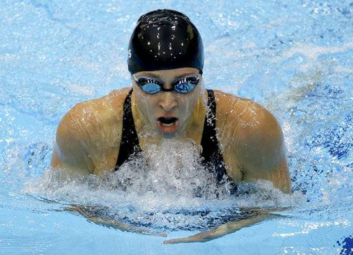 FILE - In this July 30, 2012, file photo, United States' Ariana Kukors competes in a women's 200-meter individual medley swimming heat at the Aquatics Centre in the Olympic Park during the Summer Olympics in London. Investigators have searched the Seattle home of a former U.S. Olympic Team swimming coach amid allegations that he sexually abused and took explicit photos of Kukors when she was underage.Homeland Security taskforce investigators along with police in Washington state served a search warrant at 46-year-old Sean Hutchison's Seattle apartment Tuesday, Feb. 6, 2018, recovering electronic devices they say may contain evidence, the SeattlePI reported.