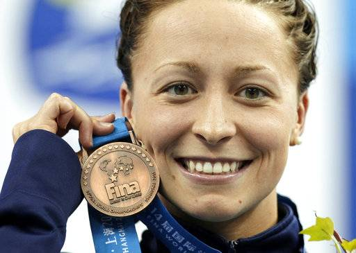 FILE - In this July 25, 2011, file photo, Ariana Kukors, of the United States, holds her bronze medal for the women's 200-meter Individual Medley final at the FINA 2011 Swimming World Championships in Shanghai, China. The U.S. Olympic champion swimmer has accused a team coach of sexually abusing her starting when she was 16, the latest misconduct allegations against those charged with caring for young athletes. Ariana Kukors, now 28, told authorities that Sean Hutchison sexually abused her as a minor and took thousands of sexually explicit photographs of her.