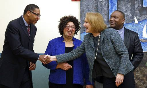 Seattle Mayor Jenny Durkan, second right, greets pastors Robert Jeffrey, left, Wilhelmina Daniel and Ricky Willis before beginning a news conference announcing plans for the city to move to vacate misdemeanor marijuana possession convictions, Thursday, Feb. 8, 2018, in Seattle. Five years after Washington state legalized marijuana, Seattle officials say they're moving to automatically clear past misdemeanor convictions for pot possession. San Francisco recently took the same step.