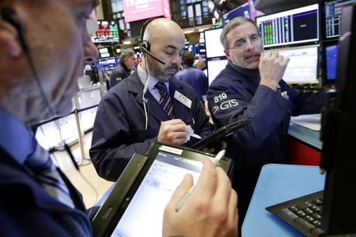 Trader Fred DeMarco, center, and specialist Anthony Rinaldi, right, work on the floor of the New York Stock Exchange, Thursday, Feb. 8, 2018. U.S. stocks are lower Thursday morning as losses from the previous day continue.