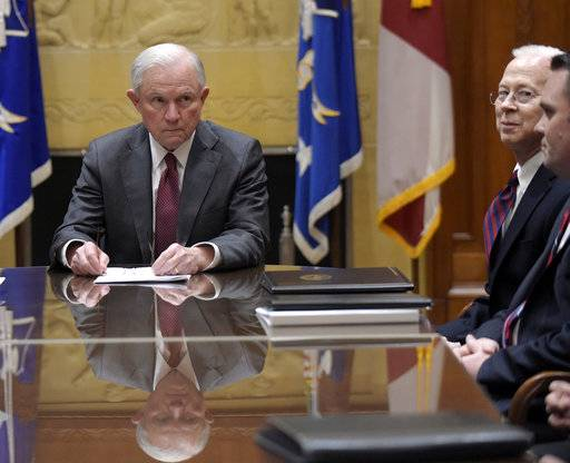 FILE - In this Feb. 9, 2017 file photo, Attorney General Jeff Sessions, left, holds a meeting with the heads of federal law enforcement components at the Department of Justice in Washington,.  Acting Deputy Attorney General Dana Boente is at right. Boenete, an understated career federal prosecutor, has found himself at the epicenter of several of the Trump administration's biggest controversies.