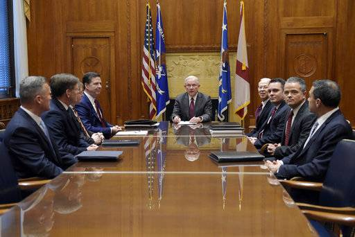 FILE - In this Feb. 9, 2017 file photo, Attorney General Jeff Sessions holds a meeting with the heads of federal law enforcement components at the Department of Justice in Washington, Thursday, Feb. 9, 2017. Seated at the table are, from left, ATF Acting Director Thomas Brandon, U.S. Marshals Acting Director David Harlow, DEA Acting Administrator Chuck Rosenberg, FBI Director James Comey, Sessions, center, Acting Deputy Attorney General Dana Boente, Acting Principal Associate Deputy Attorney General James Crowell, Attorney General Chief of Staff Jody Hunt and Associate Deputy Attorney General Armando Bonilla.  Boenete, an understated career federal prosecutor, has found himself at the epicenter of several of the Trump administration's biggest controversies.