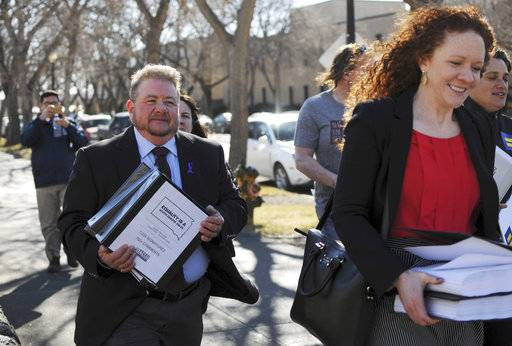 "FILE - In this Feb. 23, 2016, file photo, Terri Bruce, left, walks toward the state Capitol in Pierre, S.D. Bruce said a new South Dakota bill to ban public school teaching on gender identity in elementary and middle schools would have unintended consequences and send a message to transgender children that ""they are somehow not human."""