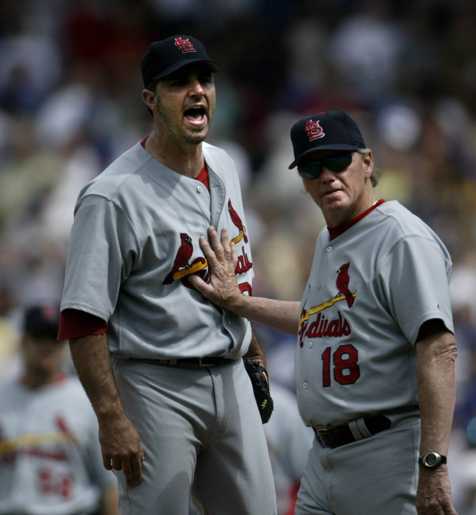 Cardinals pitching coach Dave Duncan holds back pitcher Matt Morris after after players returned to the dugout during a Cubs-Cardinals game, after a bench clearing. Duncan rejoined the White Sox on Thursday as a pitching consultant. Duncan, 72, was a major-league pitching coach for 32 years and was in the Sox's dugout from 1983-86.