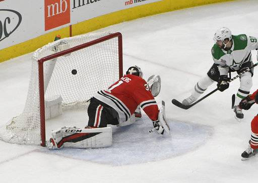 Dallas Stars center Tyler Seguin (91) scores a goal on Chicago Blackhawks goaltender Anton Forsberg (31) during the second period of an NHL hockey game Thursday, Feb. 8, 2018, in Chicago.