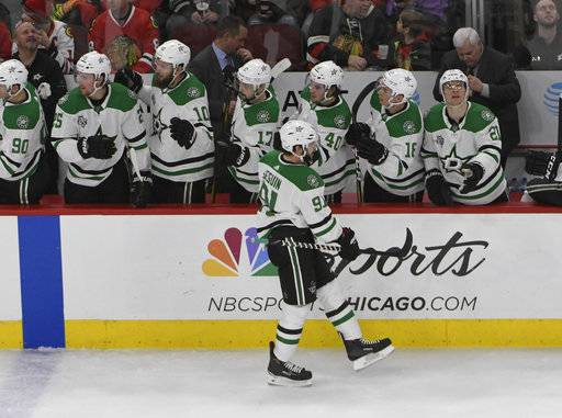 Dallas Stars center Tyler Seguin (91) celebrates his goal against the Chicago Blackhawks with his teammates during the second period of an NHL hockey game Thursday, Feb. 8, 2018, in Chicago.