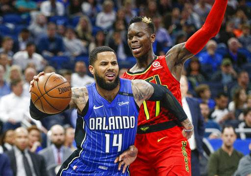 Orlando Magic guard D.J. Augustin (14) drives past Atlanta Hawks guard Dennis Schroder (17) during the second quarter of an NBA basketball game in Orlando, Fla., on Thursday, Feb. 8, 2018.
