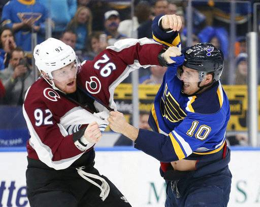 Colorado Avalanche left wing Gabriel Landeskog, left, fights with St. Louis Blues center Brayden Schenn early in the first period of an NHL hockey game Thursday, Feb. 8, 2018, in St. Louis. (Chris Lee/St. Louis Post-Dispatch via AP)