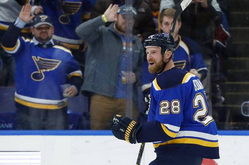 St. Louis Blues' Kyle Brodziak celebrates after scoring during the second period of an NHL hockey game against the Colorado Avalanche on Thursday, Feb. 8, 2018, in St. Louis.
