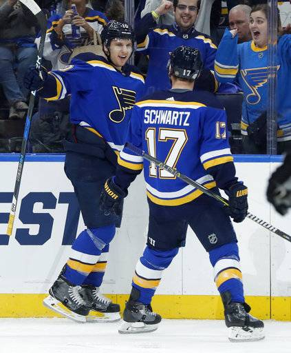 St. Louis Blues' Brayden Schenn, left, is congratulated by Jaden Schwartz (17) after scoring during the second period of an NHL hockey game against the Colorado Avalanche on Thursday, Feb. 8, 2018, in St. Louis.