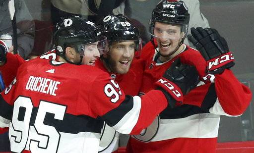 Ottawa Senators Mike Hoffman (68) celebrates his winning overtime goal against the Nashville Predators with teammates Matt Duchene (95) and Thomas Chabot (72) during NHL hockey game action in Ottawa, Ontario, Thursday, Feb. 8, 2018. (Fred Chartrand/The Canadian Press via AP)
