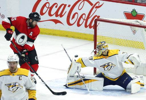 Ottawa Senators Zack Smith, top left, waits for a rebound off of Nashville Predators goaltender Juuse Saros (74) during second-period NHL hockey game action in Ottawa, Ontario, Thursday, Feb. 8, 2018. (Fred Chartrand/The Canadian Press via AP)