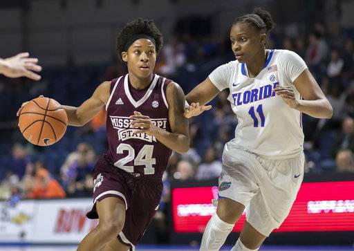 Mississippi State guard Jordan Danberry (24) drives past Florida guard Dyandria Anderson (11) during the second half of an NCAA college basketball game in Gainesville, Fla., Thursday, Feb. 8, 2018.
